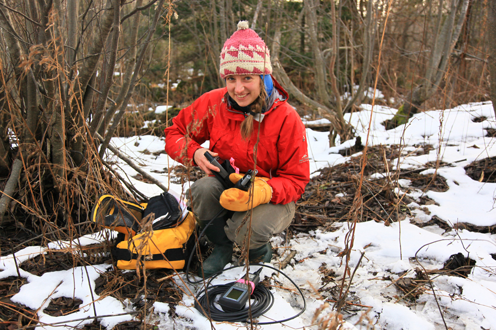 Mindy Otto using a YSI meter to conduct a water quality analysis on the Yellow Dog Plains.