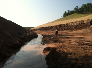 Spring water running through the construction site on the new County Road AAA, a haul road for Eagle Mine. A series of springs were ruptured during construction activities and led to the pollution of a wetland. Photo dated August 6, 2014 courtesy of Yellow Dog Watershed Preserv