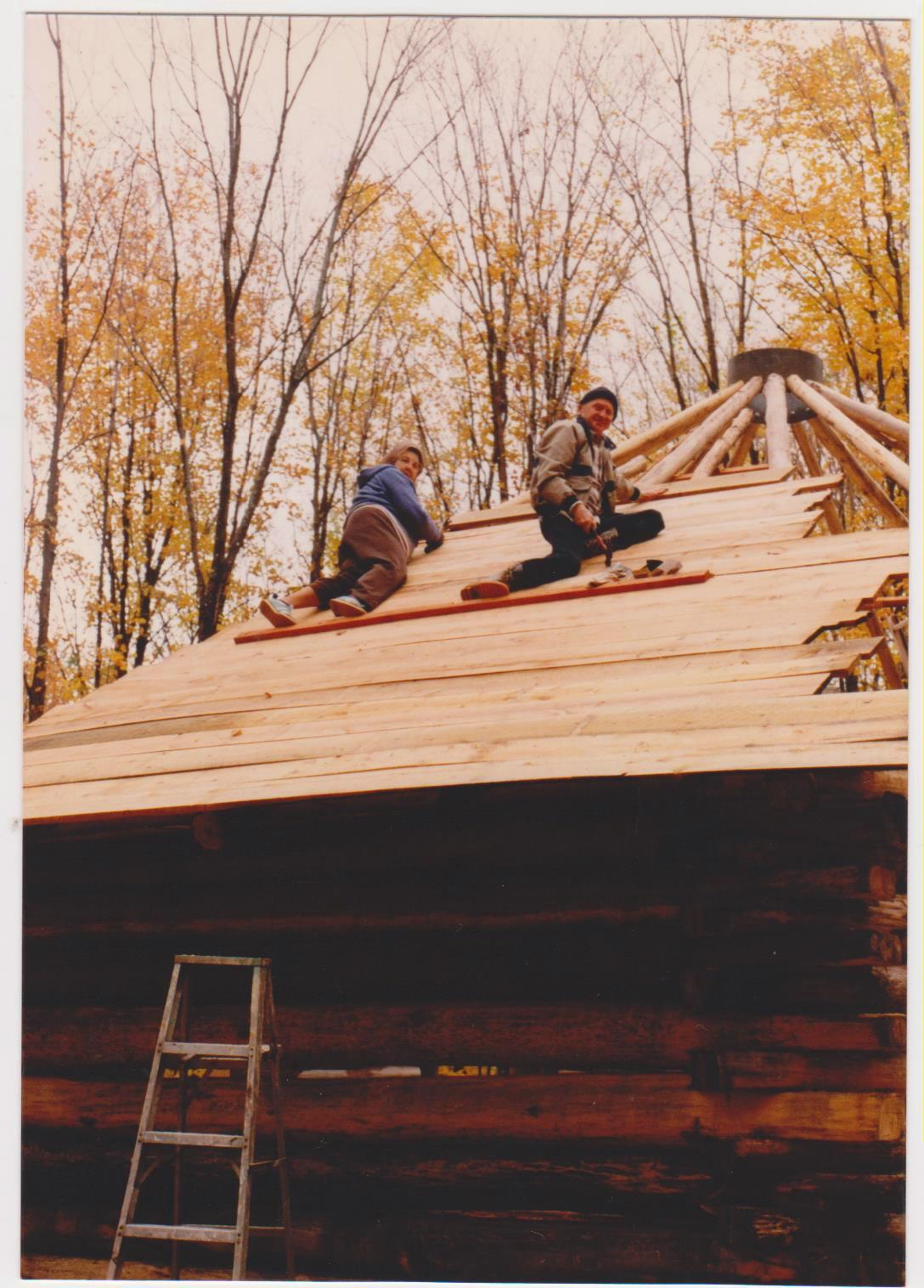 Rochelle Dale's Aunt Mildred and her dad nailing down the boards on the Zender and Dale home roof in the Yellow Dog Watershed.