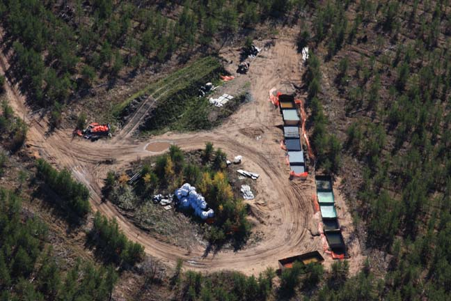 Aerial photo of exploratory drilling operations on the Yellow Dog Plains in 2007. These basins, which contain water that was in contact with sulfide rock, are full and overflowing onto the ground. Sites like this illustrate the limited regulation and oversight of exploratory drilling.